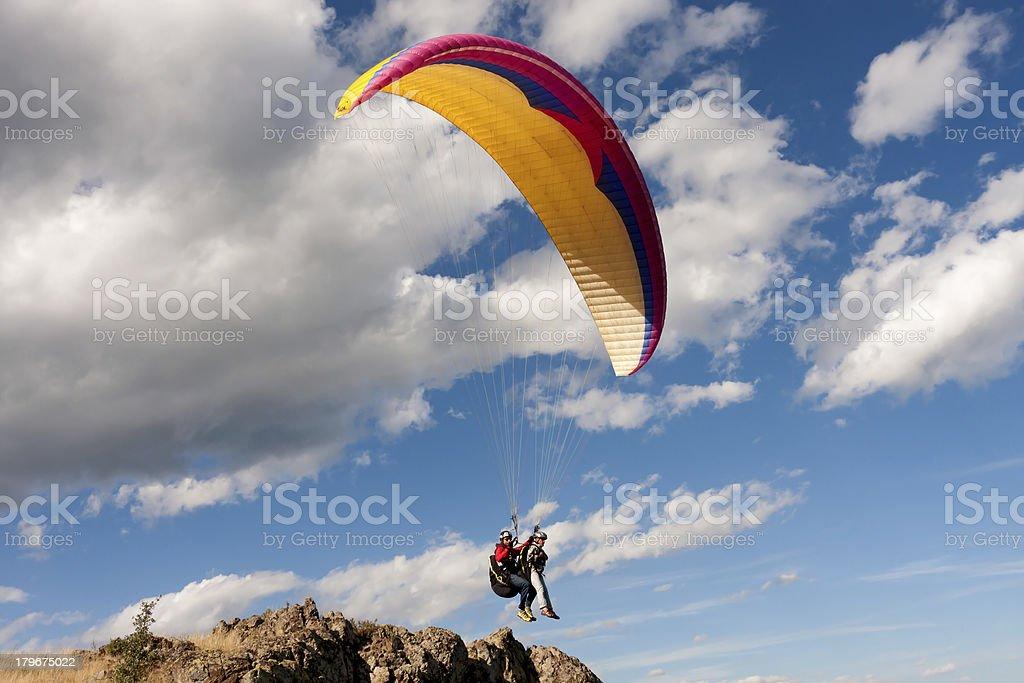 Tandem paraglider starting a flight stock photo