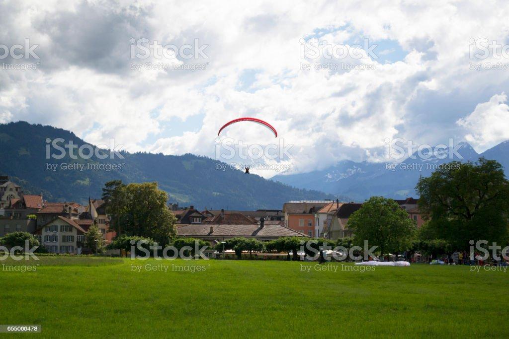 Tandem paragliding in bright blue sky in Interlaken, Switzerland stock photo