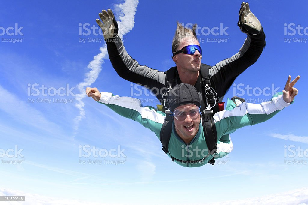 Tandem skydiving stock photo