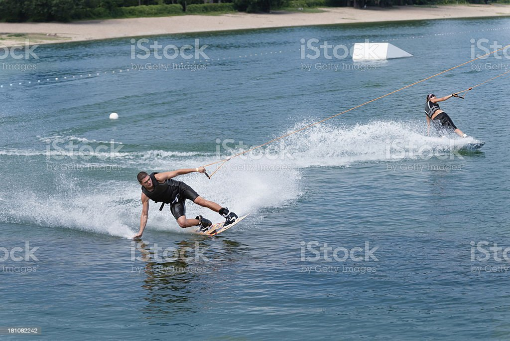 Tandem wakeboarding performance stock photo