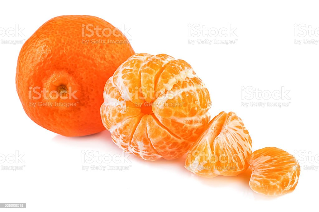 Tangerine and peeled tangerines on white background. Closeup. stock photo
