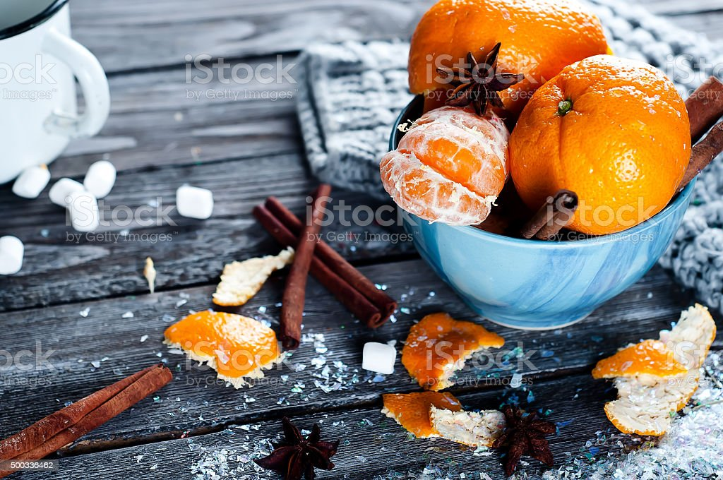 Tangerine in scarf over wooden background stock photo