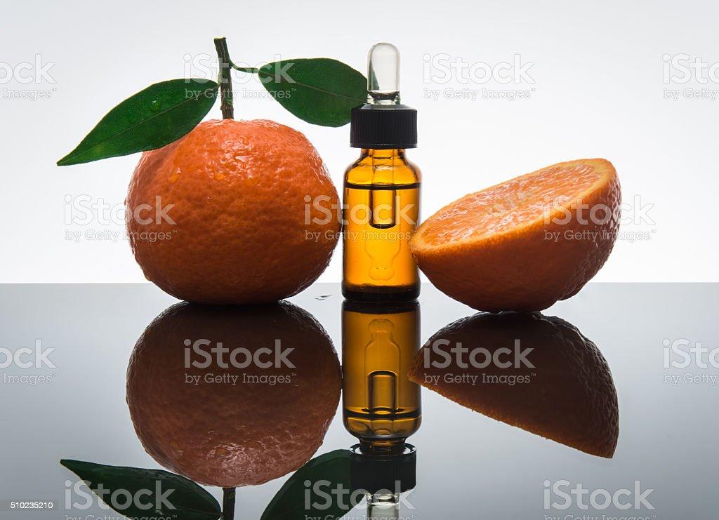 Tangerine / Mandarin essential oil bottle with dropper stock photo