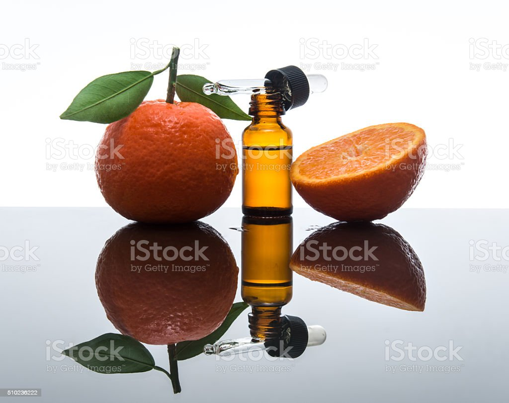 Tangerine / Mandarin essential oil bottle with dropper stock photo