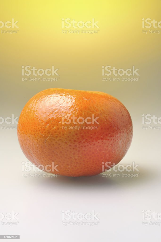 tangerine on yellow royalty-free stock photo