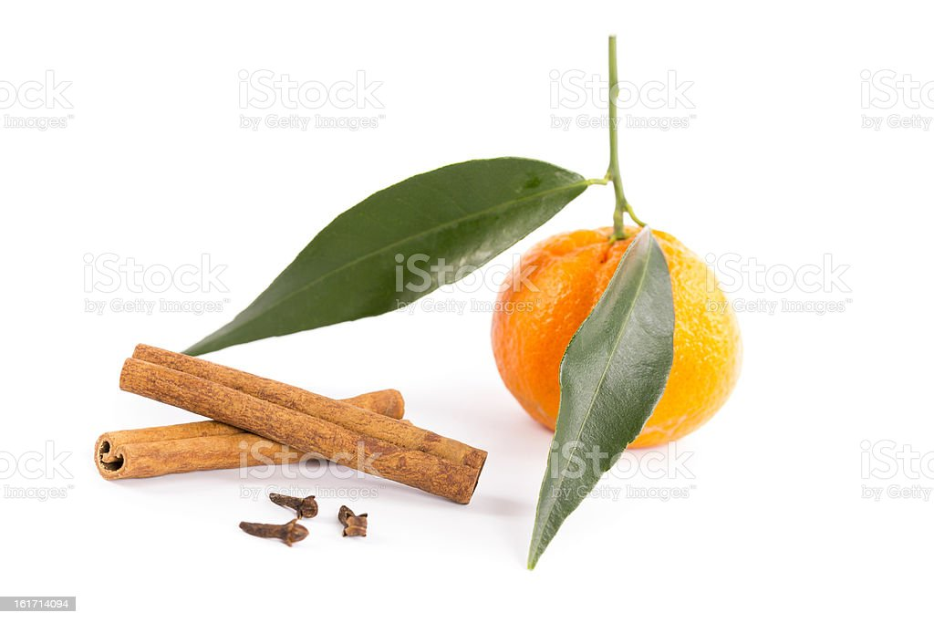 tangerine with cinnamon sticks and cloves royalty-free stock photo