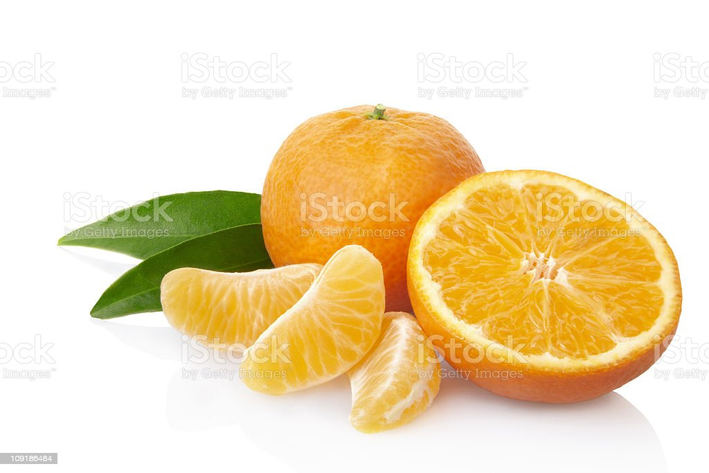 Tangerine with leaves and slices stock photo