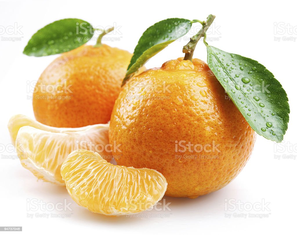 Tangerine with segments on a white background stock photo