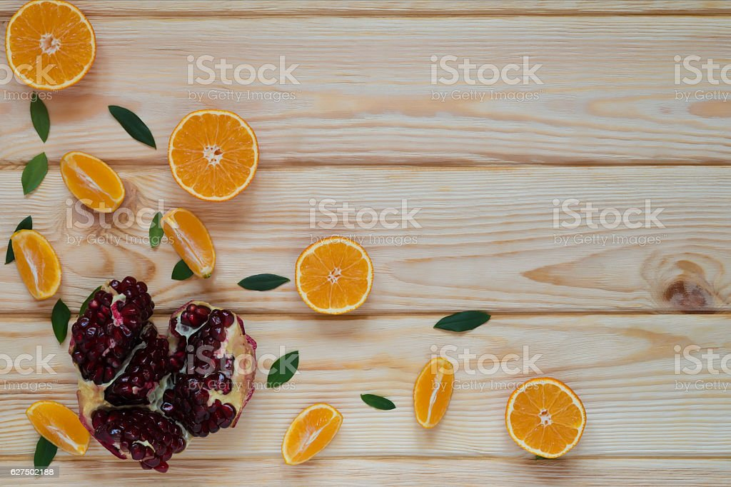 tangerines and pomegranate seeds stock photo