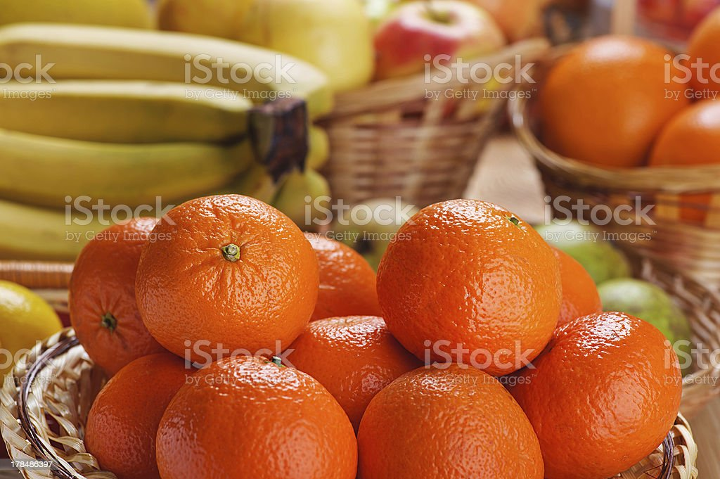 tangerines, bananas, apples and oranges royalty-free stock photo