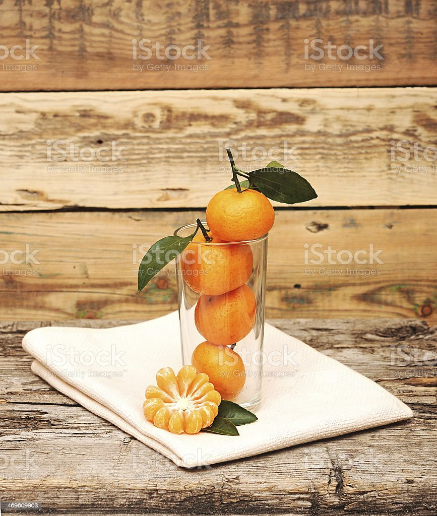 Tangerines in a glass. royalty-free stock photo