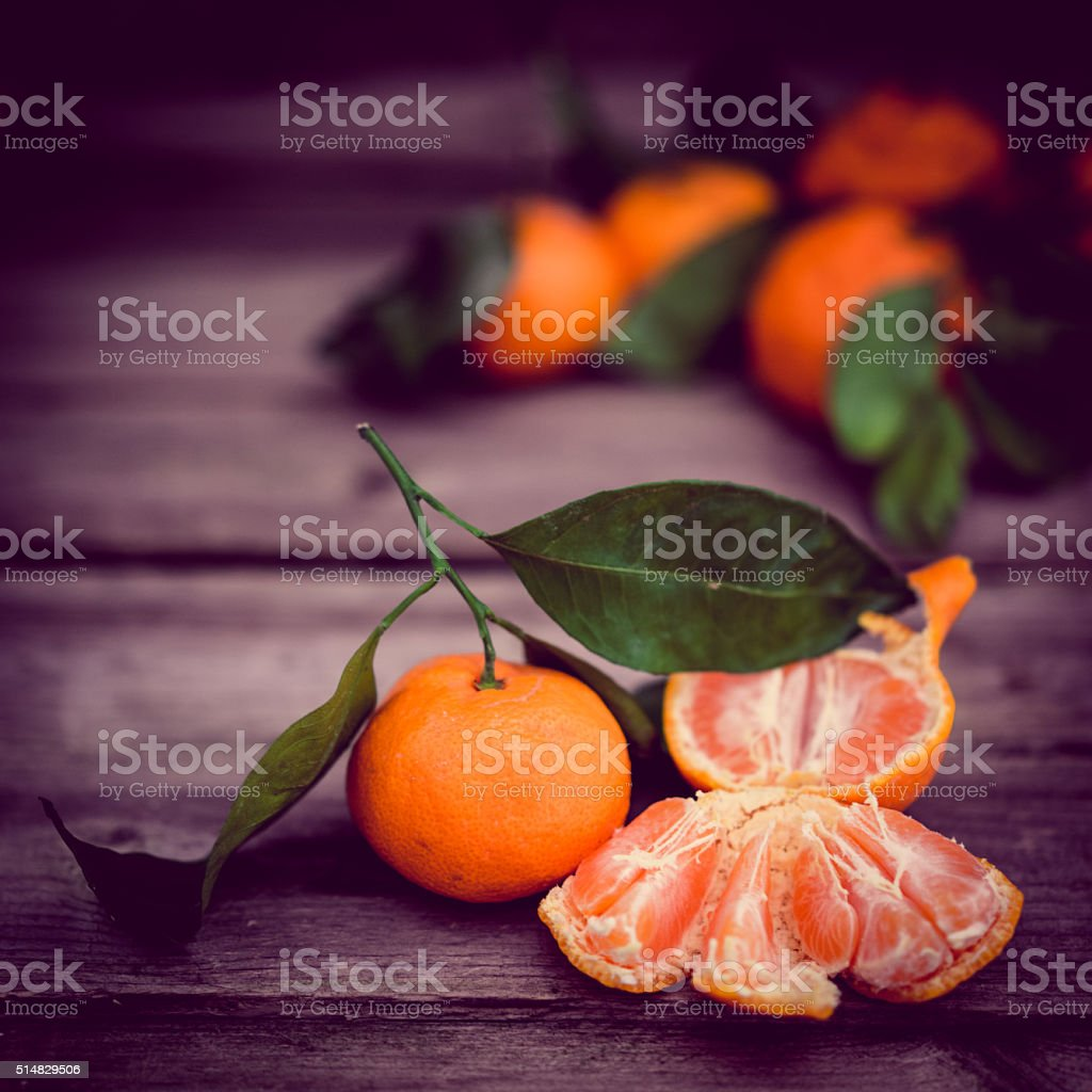 Tangerines on rustic background stock photo