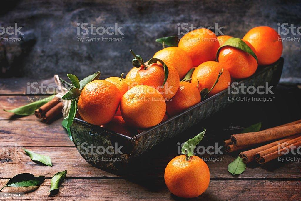 Tangerines with cinnamon stock photo