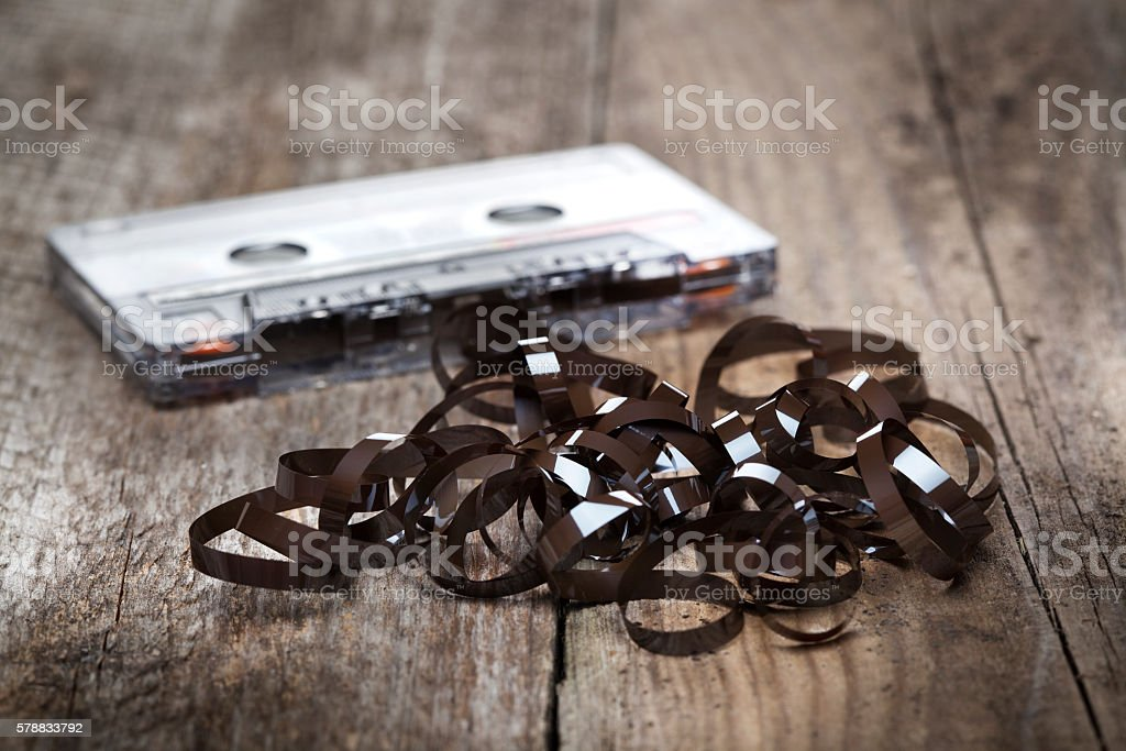 Tangled and messed up audio tape, audio Cassette. stock photo