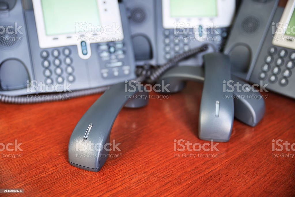 Tangled desk phone stock photo