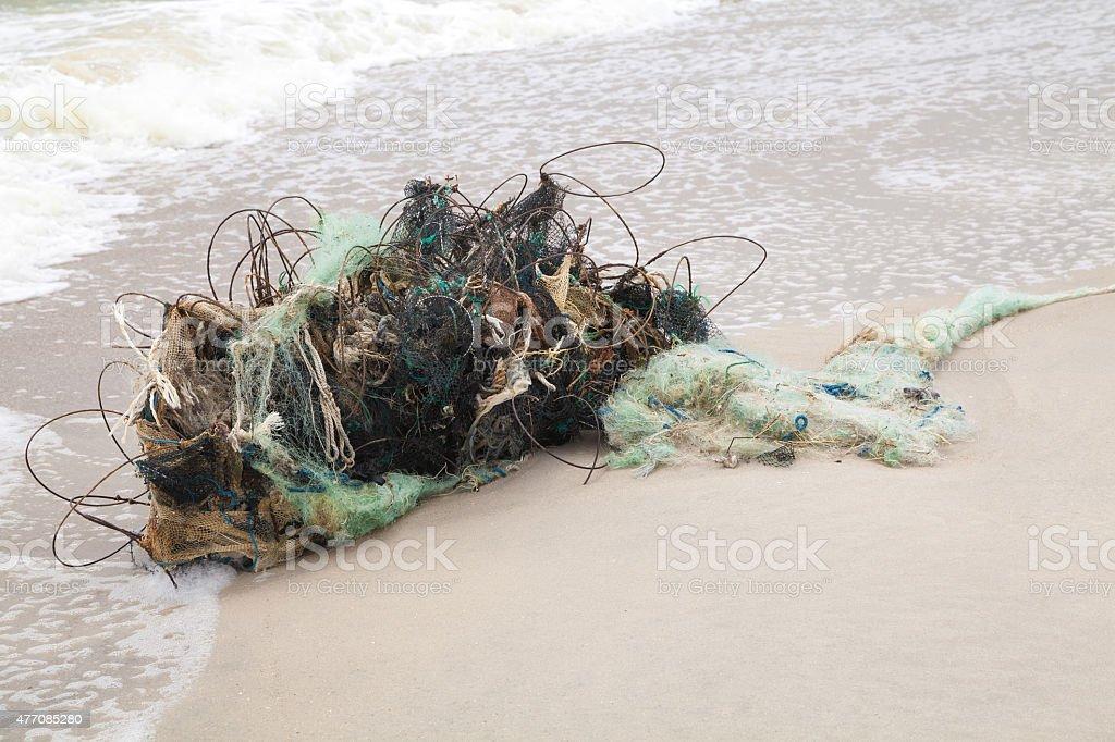 Tangled fishing nets on the beach stock photo
