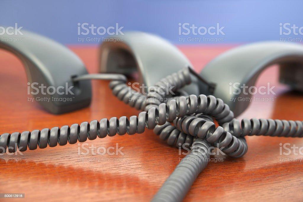 Tangled phone line stock photo