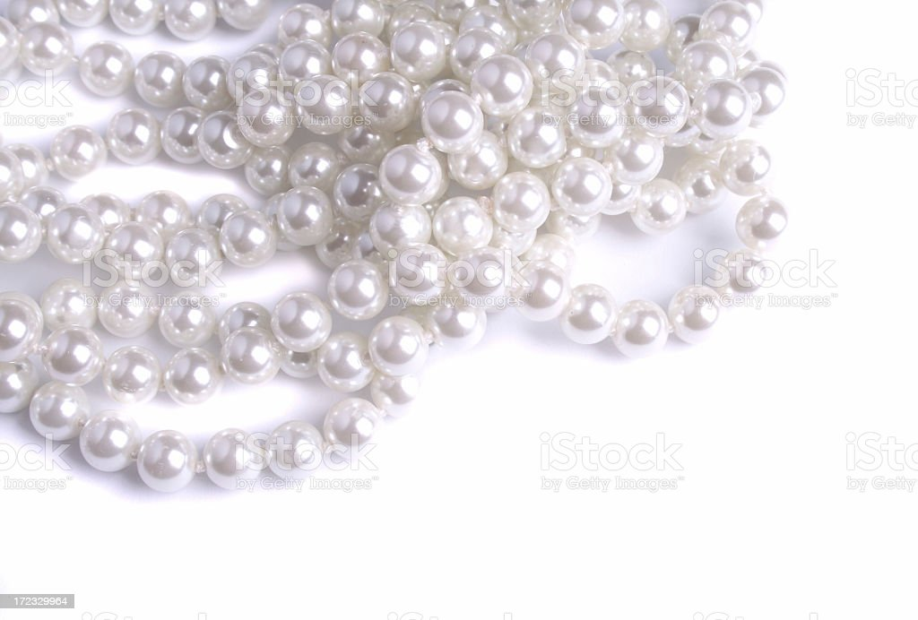 A tangled white pearl Necklace royalty-free stock photo