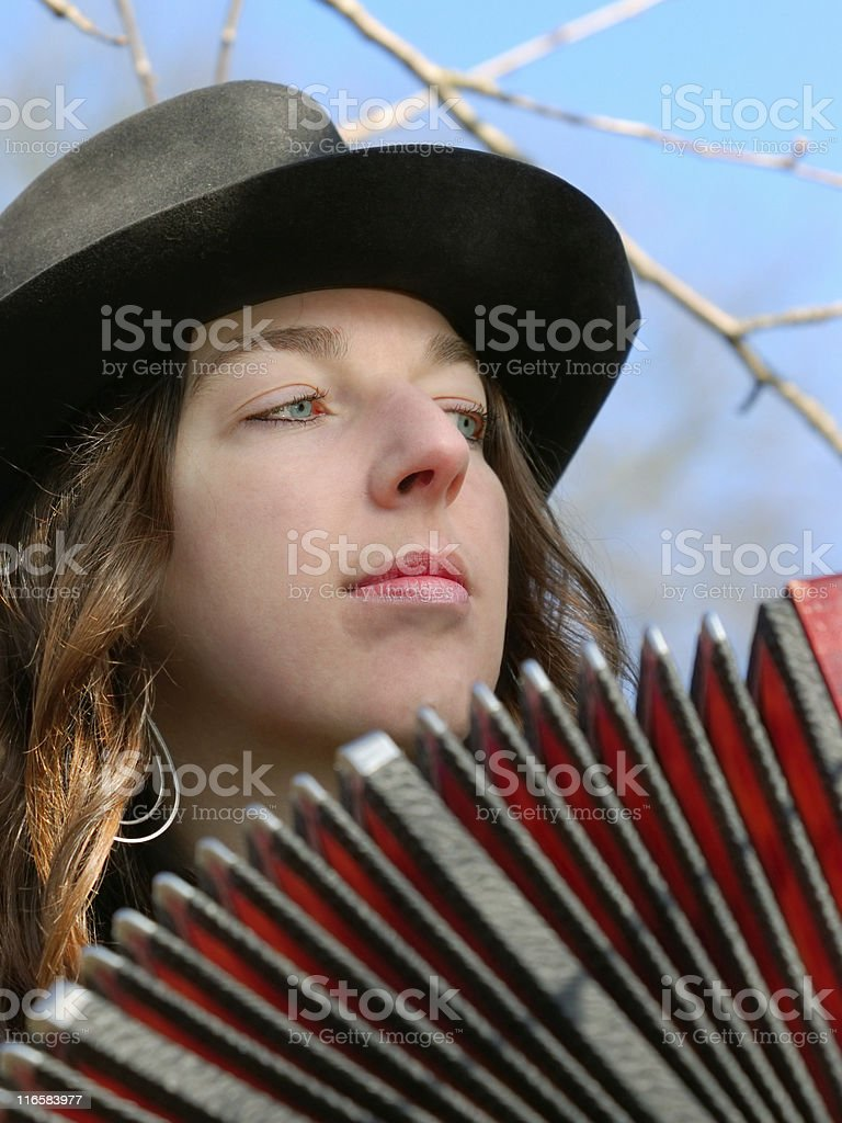 tango musician - a beautiful girl with bandoneon stock photo
