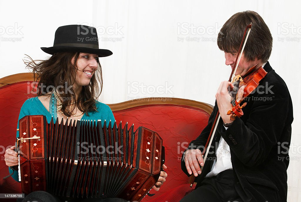 Tango musicians with bandoneon and violin stock photo
