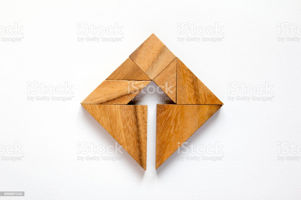 Tangram puzzle as arrow in square shape stock photo