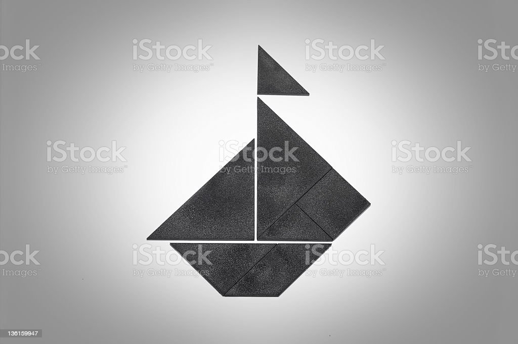 Tangram sailboat with flag stock photo