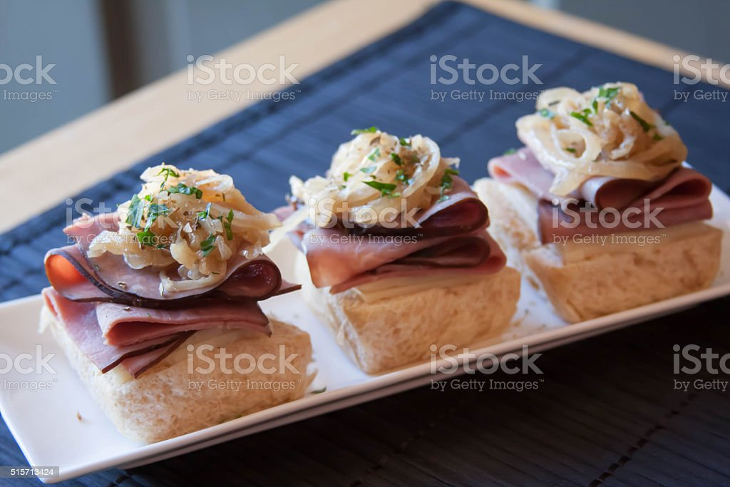 Tangy horseradish roast beef sliders on Hawaiian sweet rolls stock photo