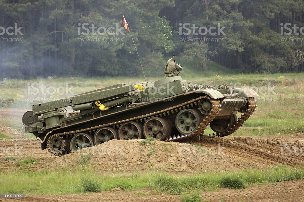 tank climbing over a hill royalty-free stock photo