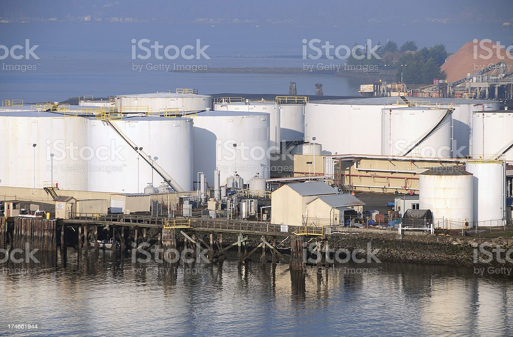 Tank farm and lumber mill royalty-free stock photo