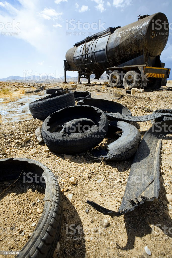 Tank Oil and Flat tire royalty-free stock photo