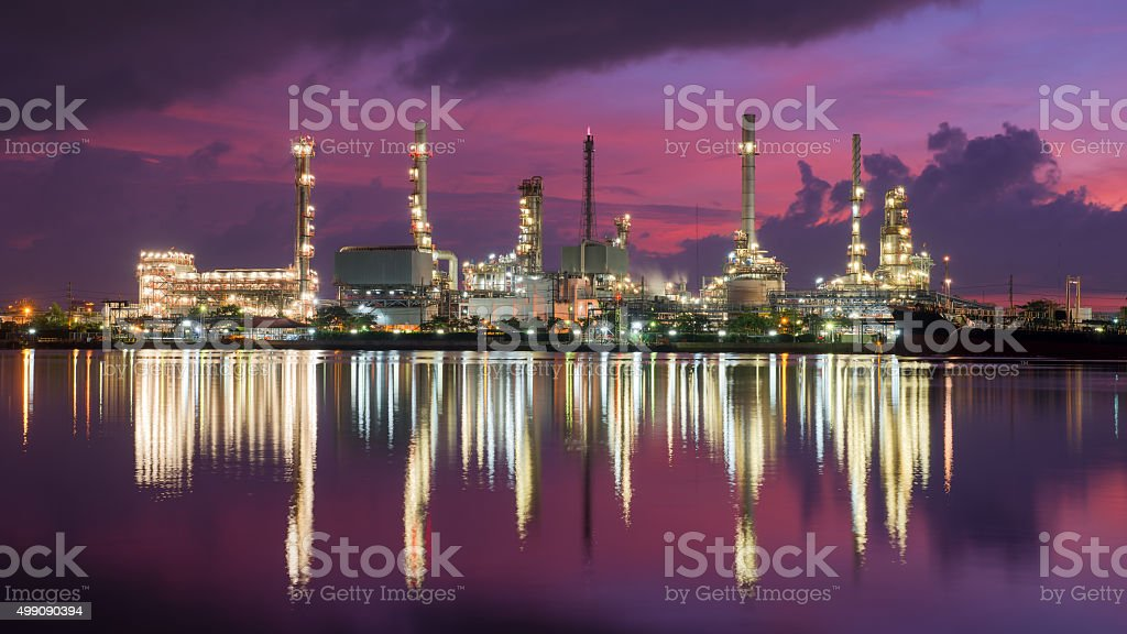 Tank ship mooring in oil refinery industry at twilight time stock photo