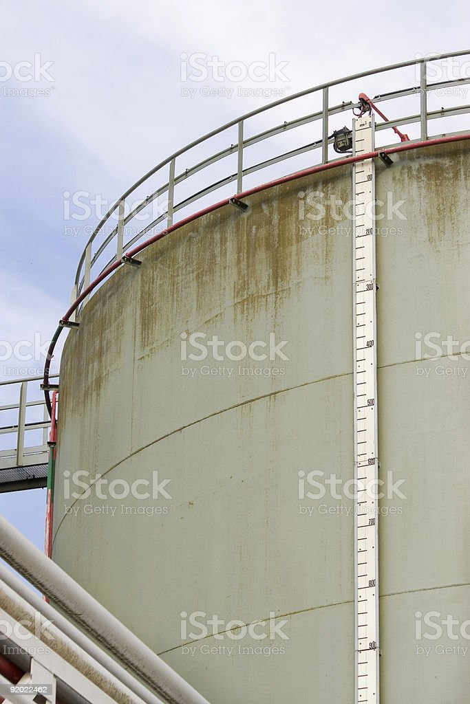 Tank with level meter stock photo