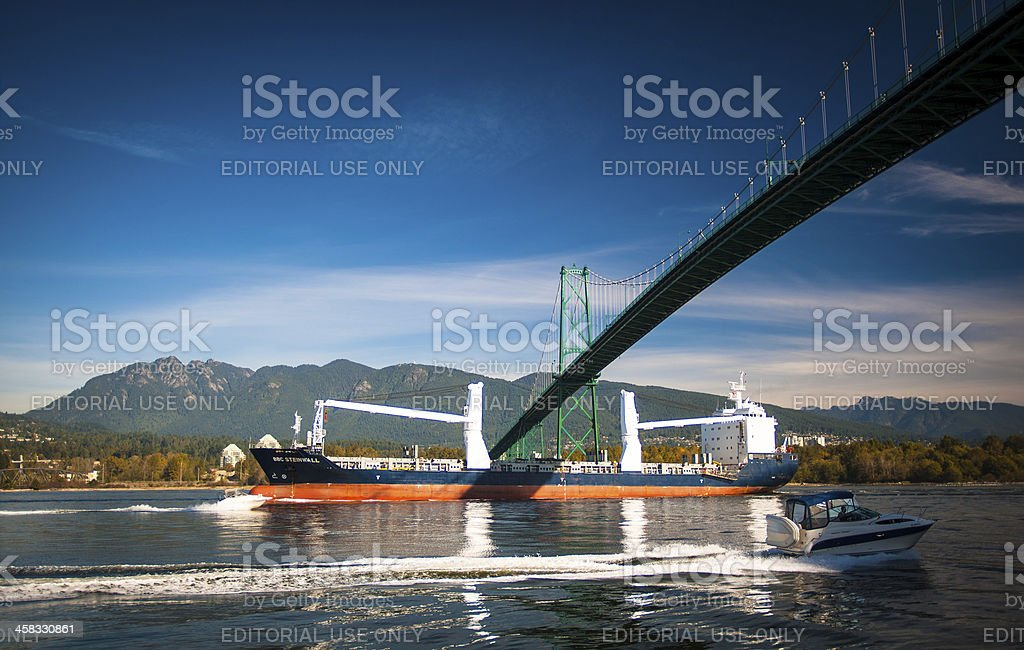 Tanker and Recreational Boat at Lion's Gate Bridge royalty-free stock photo