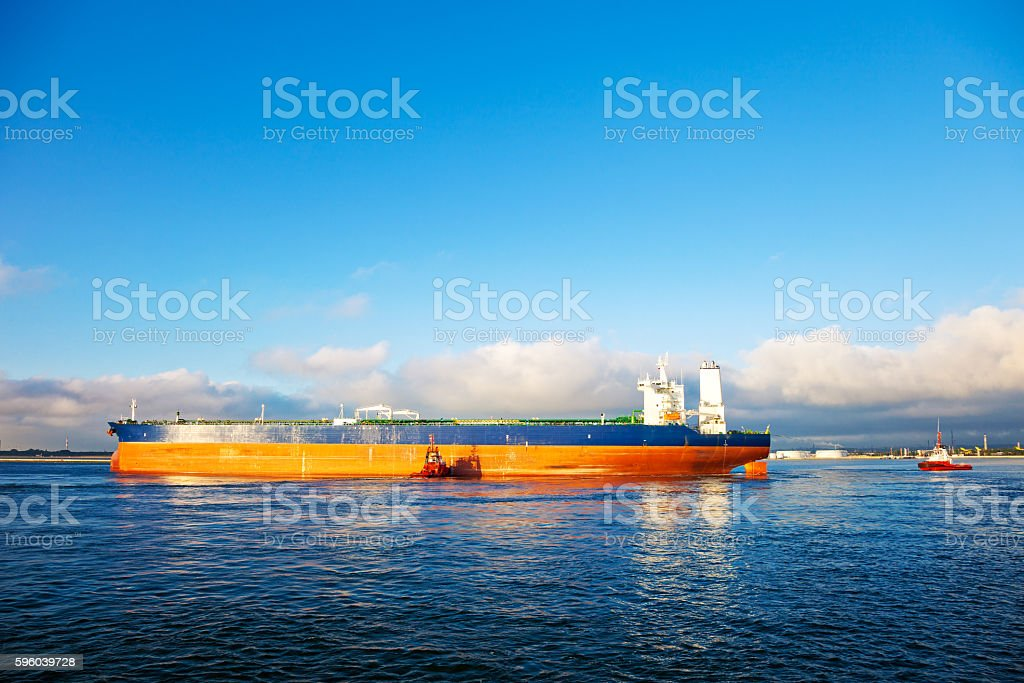 Tanker and tugs stock photo