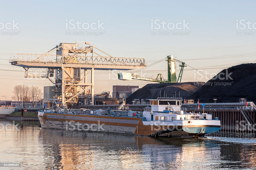 Tanker Barge Sailing on Rhine and Passing Power Plant, Germany stock photo