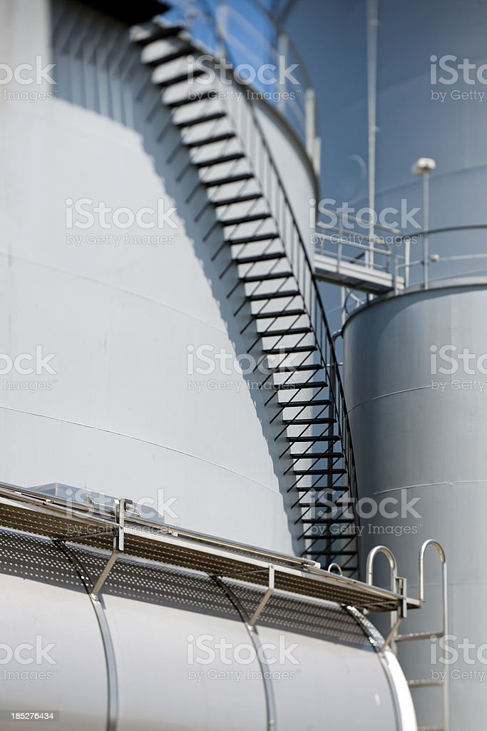 tanker lorry parked in front of storage tanks stock photo