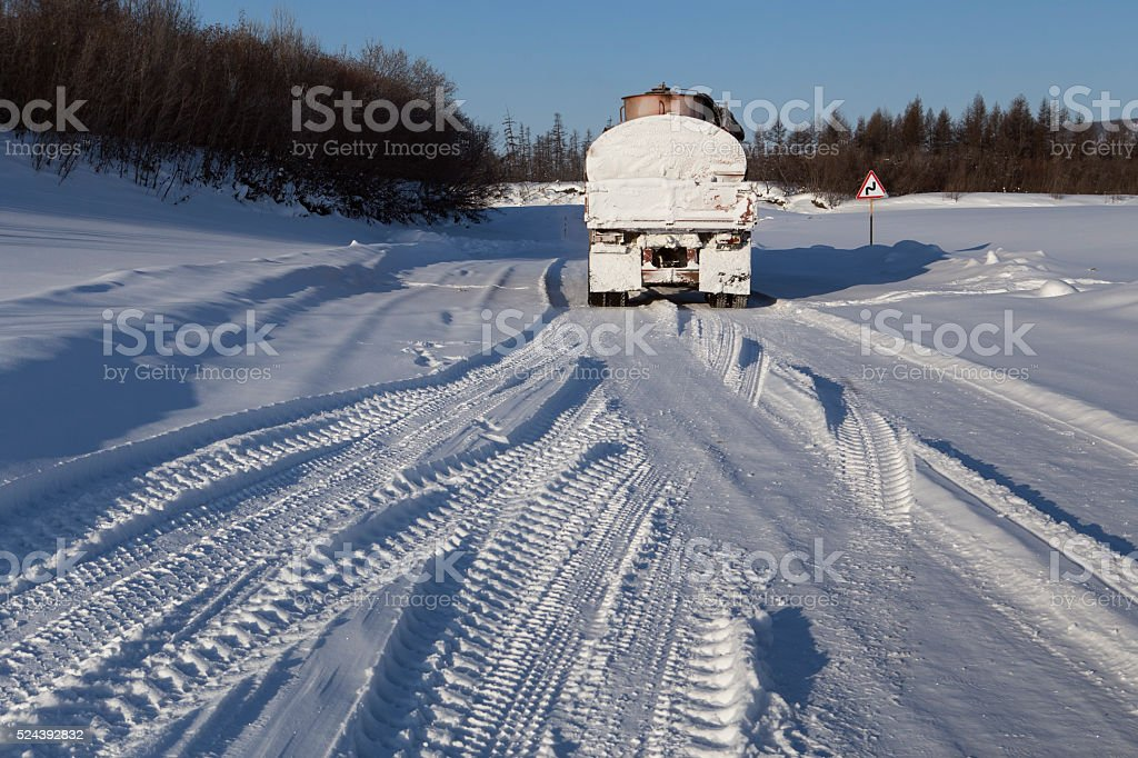 Tanker on the winter road in the snow. stock photo