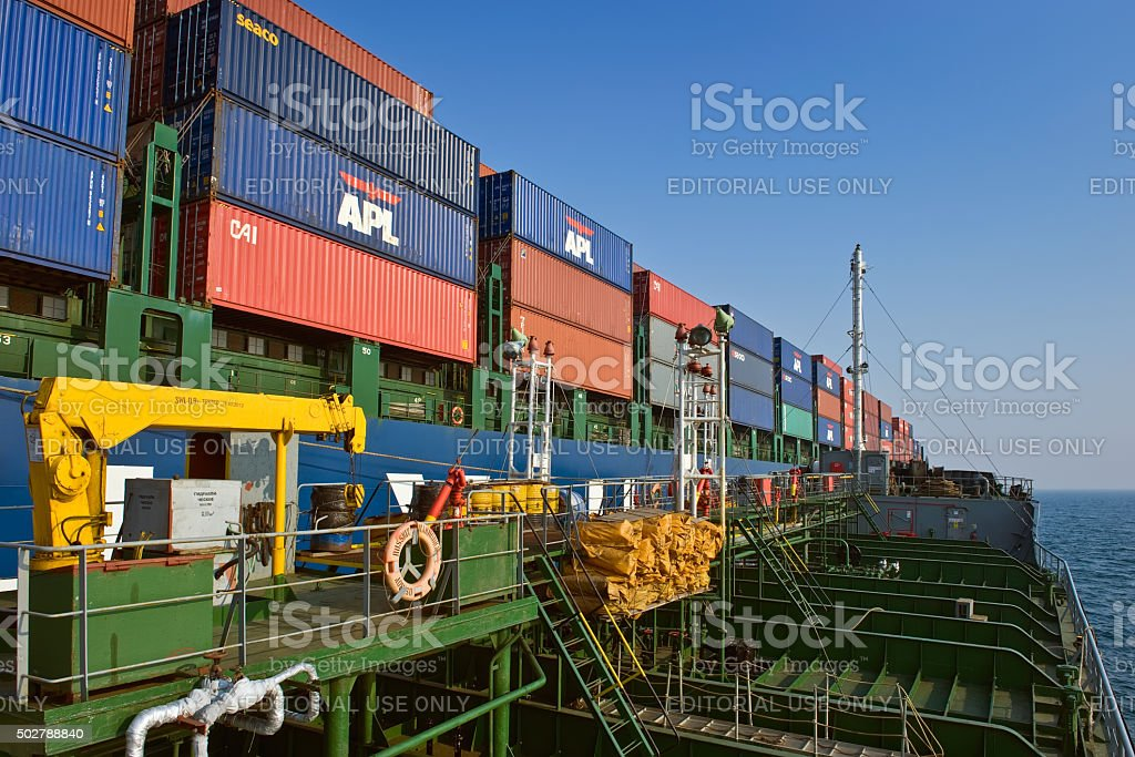 Tanker Ostrov Russkiy raid bunker on the container ship. stock photo