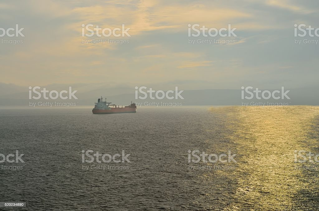 Tanker Sailing into the Sunset stock photo