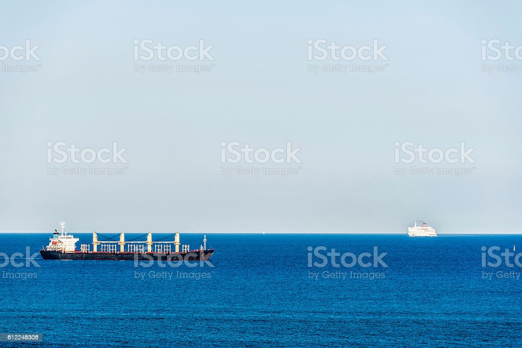 Tanker ship and a cruise stock photo