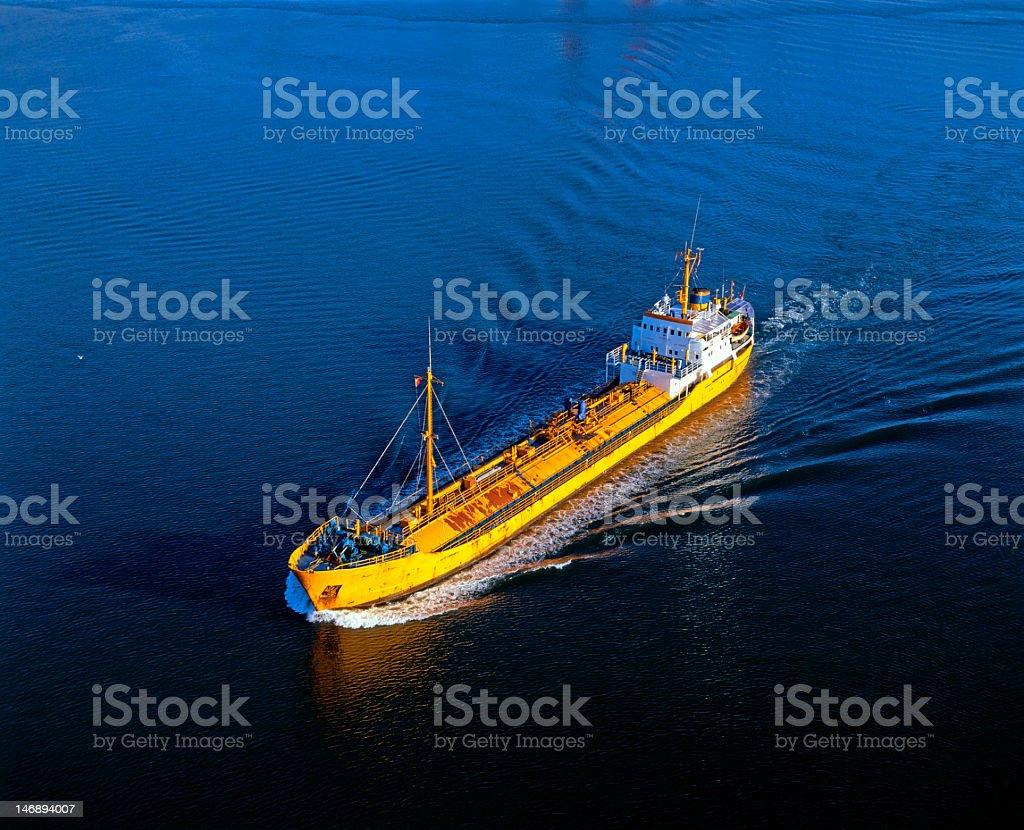 Tanker ship sailing in dark lake royalty-free stock photo