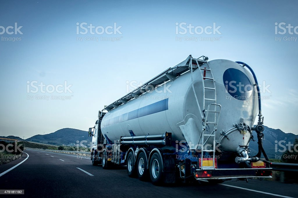 Tanker truck on highway stock photo