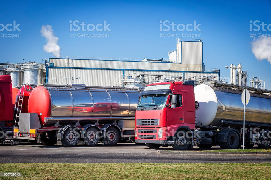 Tanker trucks in the parking lot in front of the factory stock photo