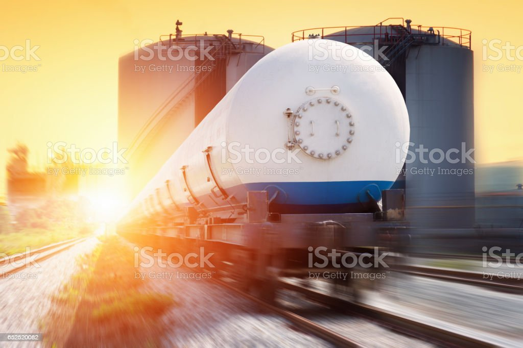 Tanks with gas being transported by rail at sunset stock photo