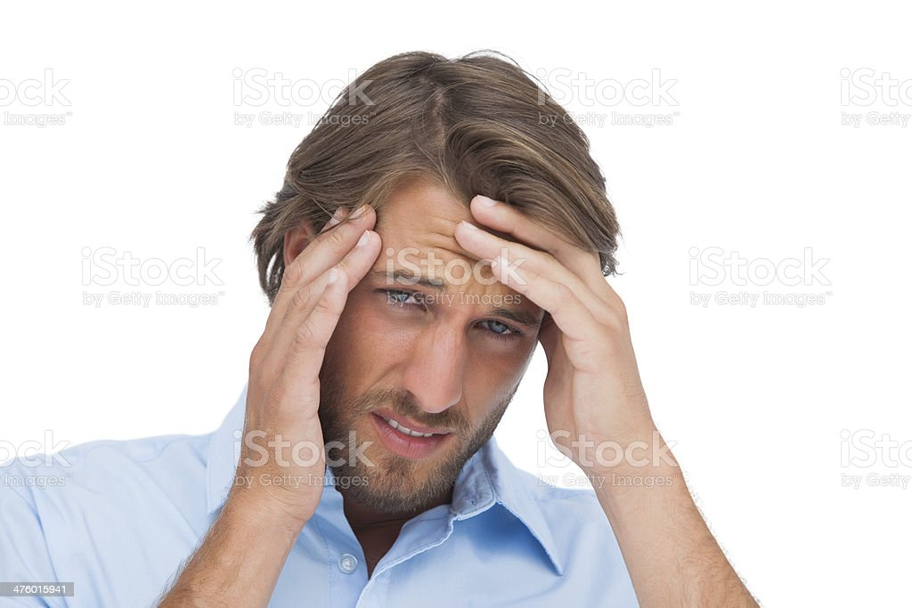 Tanned man having a strong headache royalty-free stock photo