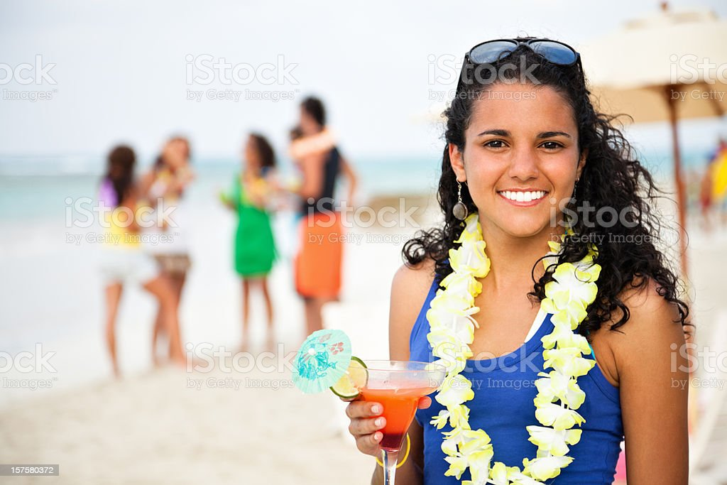 Tanned young cute woman in a beach party royalty-free stock photo