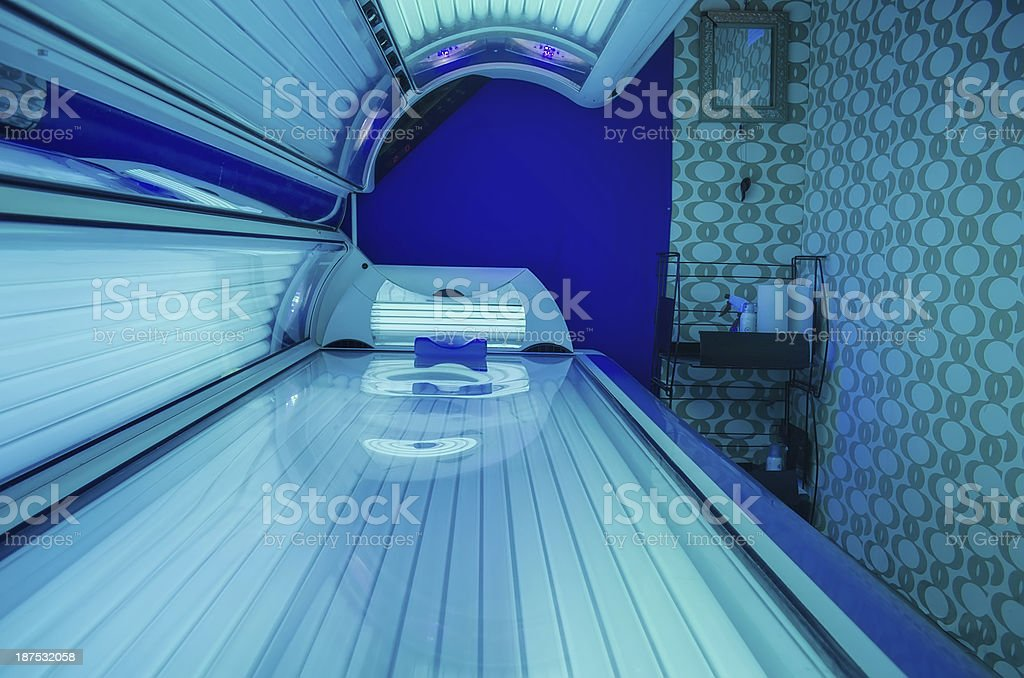 Tanning bed in salon stock photo