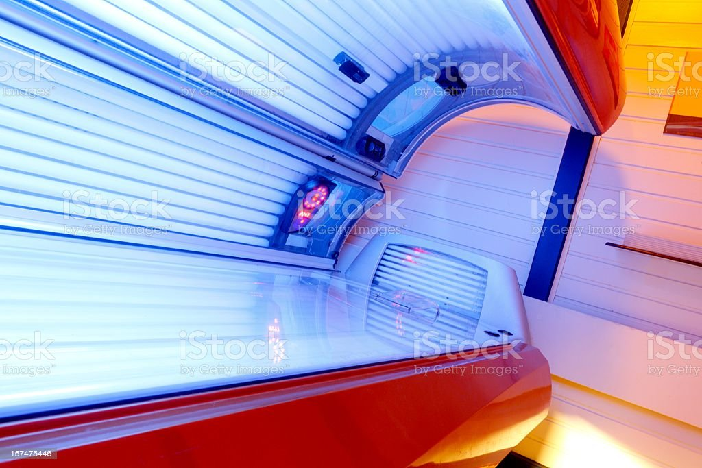Tanning Bed - open and lights switched on stock photo