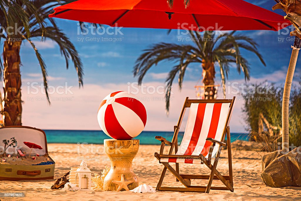 Tanning beds and sea ball on the tropical beach stock photo