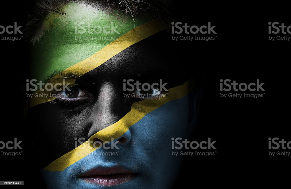 Tanzania flag on face stock photo